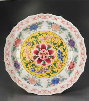 A Yongle period dish, Kangxi Yuzhi mark and enamels of the period