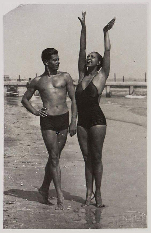 Josephine Baker and the Russian-born French ballet legend, Serge Lifar on the Lido beach in Venice, 1930