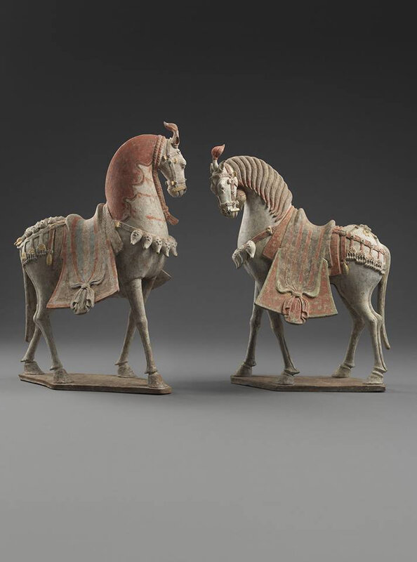 Two Painted Earthenware Caparisoned Horses, Northern Qi period, 550 - 577. Height: 63.0cm and 58.0cm. The Norman A. Kurland Collection. © Eskenazi