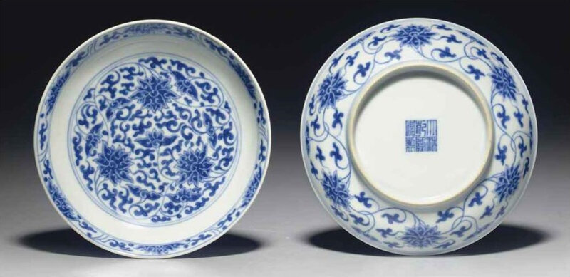 A pair of blue and white 'lotus' dishes, Qianlong seal marks in underglaze blue and of the period (1736-1795)