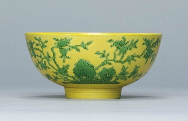 A rare incised yellow-ground green enamelled bowl,Yongzheng six-character mark within a double circle in aubergine enamel and of the period (1723-1735)
