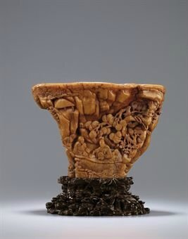A rare and superbly carved 'Orchid Pavilion' rhinoceros horn libation cup. Ming dynasty, early 17th century. photo Sotheby's
