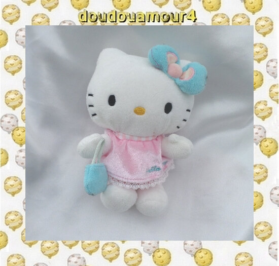 Peluche Doudou Hello Kitty Noeud Sac à Main Bleu Robe Rose Sanrio Jemini 14 cm