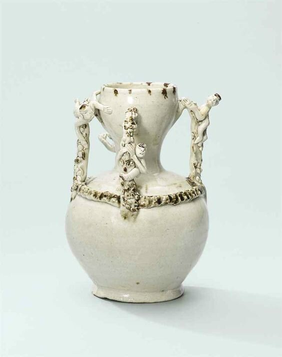 An iron-spot decoratedqingbaivase, Song dynasty (960-1279)