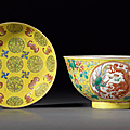 A yellow-ground 'dragon and phoenix' medallion bowl, and a famille rose 'shou and bats' dish, guangxu marks and period
