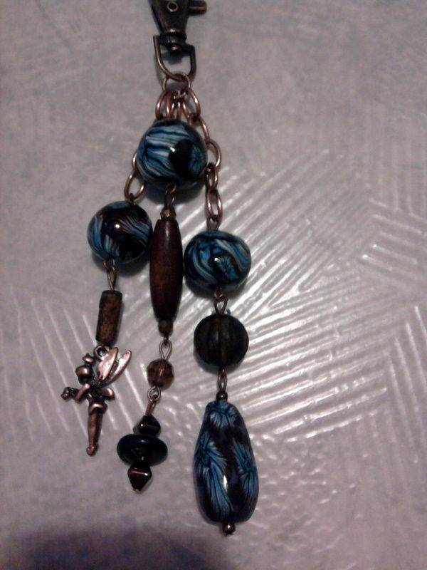 bijou de sac fleur bleue