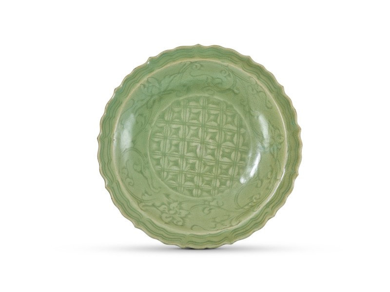 A Longquan celadon carved 'floral' dish, Ming dynasty (1368-1644)