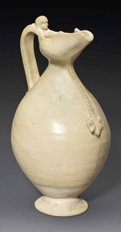 A small straw-glazed white stoneware ewer, Sui-early Tang dynasty, 6th-7th century