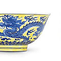 A fine yellow-ground blue and white 'dragon' bowl, kangxi six-character mark within double-circles and of the period (1662-1722)
