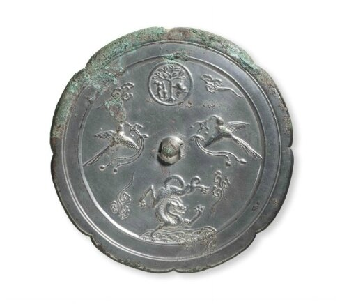A silvery bronze octalobed mirror, China, Tang dynasty (AD 618-907)