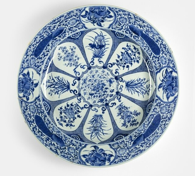 A large blue and white 'Peackock and flower' blue and white porcelain plate from the collection of Augustus the Strong (1670-1733), China, Kangxi period, Johanneums mark N