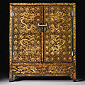 A large chinese brown-ground and gilt-decorated lacquer cabinet (gui), ming dynasty, wanli period and later