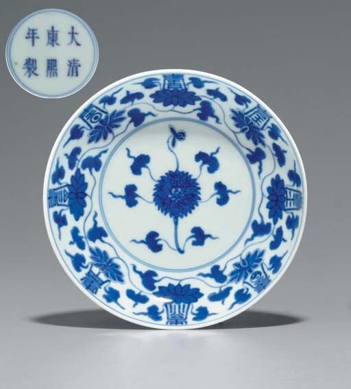 A_blue_and_white_Shou_character_saucer_dish__Kangxi_six_character_mark_in_underglaze_blue_within_a_double_circle_and_of_the_period__1662_1722_