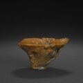 An elegantly carved rhinoceros horn libation cup, 17th-18th century. Photo Bonhams.