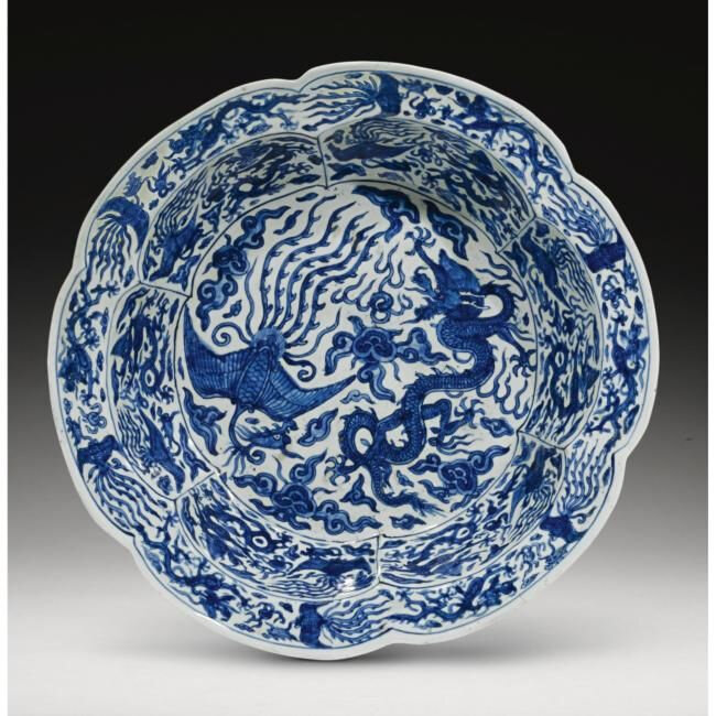Lot 55. A blue and white 'dragon and phoenix' basin, Wanli Mark And Period (1573-1619); 36.3cm., 14 1/4 in., diam. Estimate 50,000—70,000 GBP. Lot Sold 61,250 GBP. Photo Sotheby's