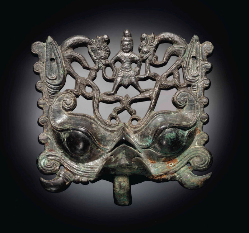 2014_NYR_02830_2041_000(a_rare_bronze_openwork_taotie_mask_fitting_northern_wei_dynasty_5th_ce)