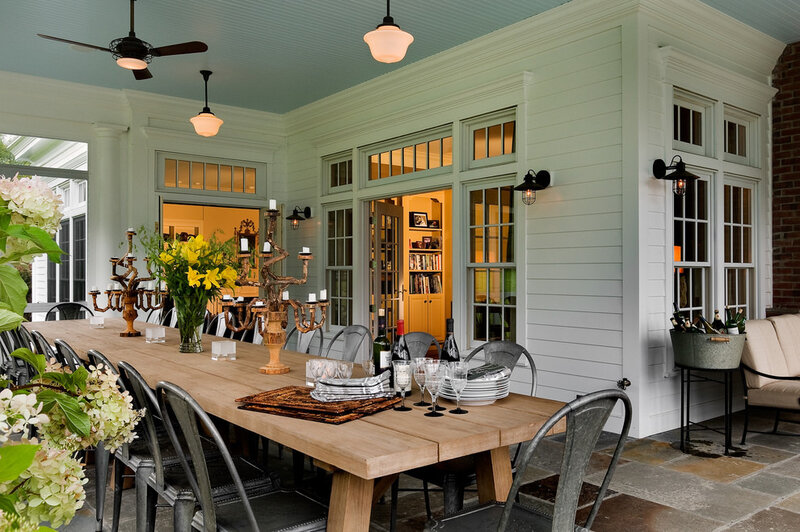 Splashy-Harbor-Breeze-Fans-vogue-New-York-Traditional-Porch-Decorating-ideas-with-beadboard-ceiling-big-table-bright-big-table-bright-porch-country-home-dining-porch-farmh