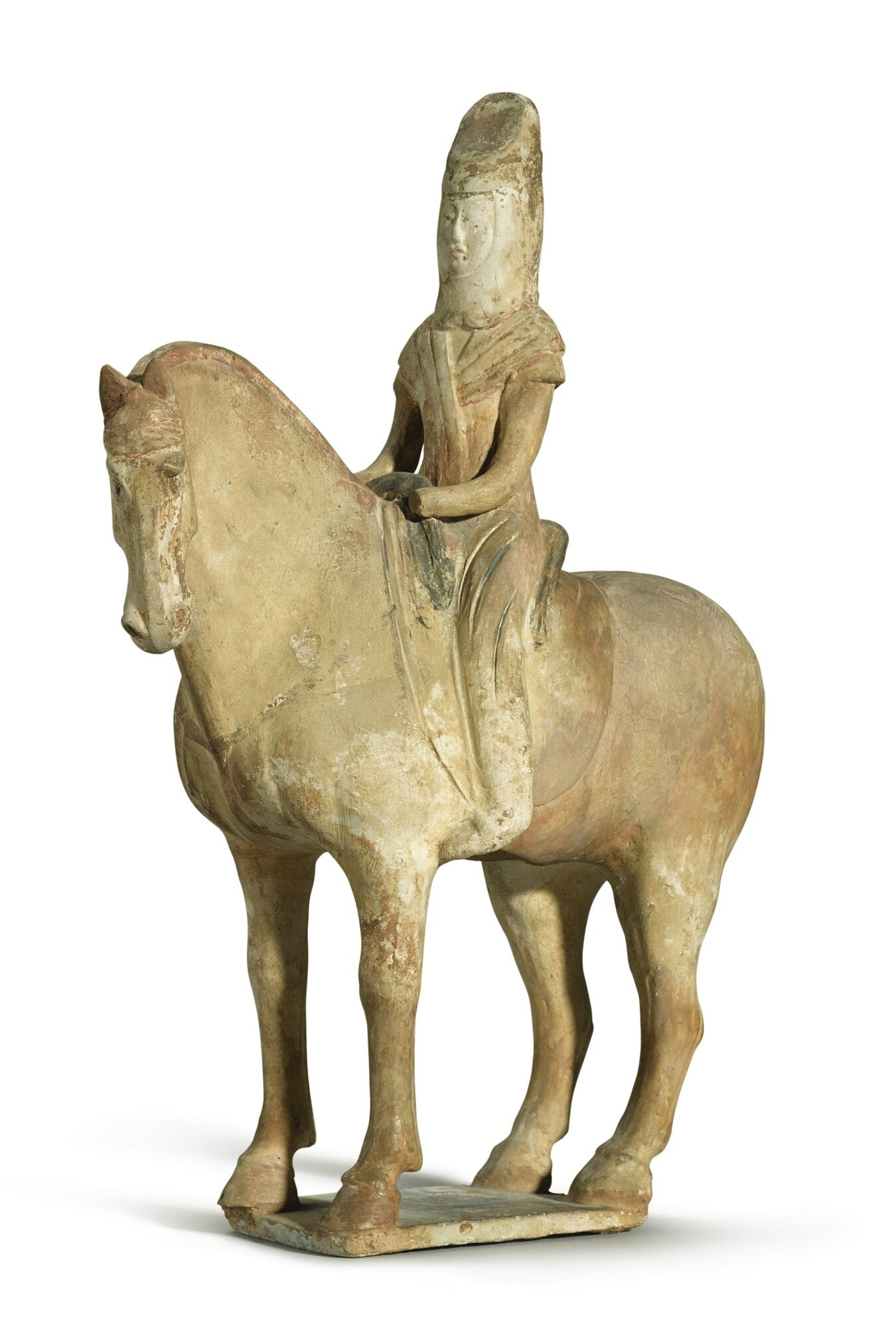 A painted pottery figure of an equestrian, Early Tang dynasty