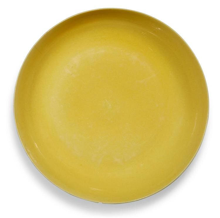 An imperial yellow-glazed dish, Hongzhi mark and period (1488-1505)