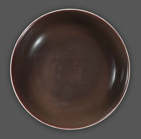A copper red glazed deep dish, Daoguang six-character mark and of the period. Photo Bonhams