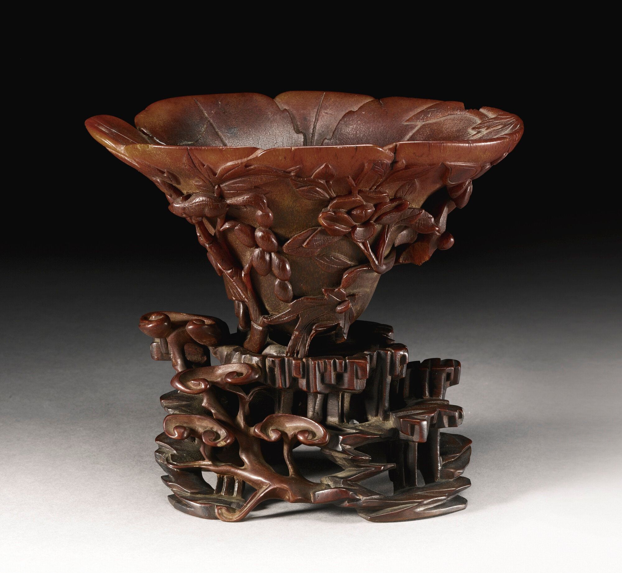 A rhinoceros horn 'Squirrel and grapevine' libation cup, Qing dynasty, 17th-18th century