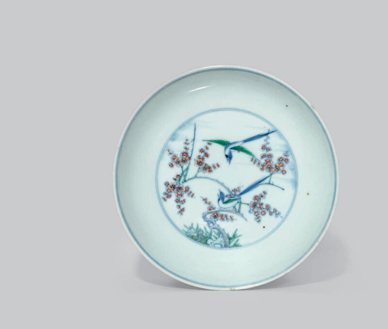 A doucai 'magpie and prunus' dish, Kangxi six-character mark in underglaze blue within a double circle and of the period (1662-1722)