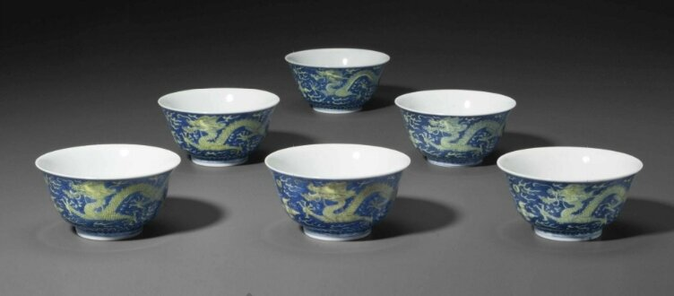 A set of six small underglaze blue and yellow-glazed 'Dragon' bowls,Daoguang six-character seal marks in underglaze blue and of the period