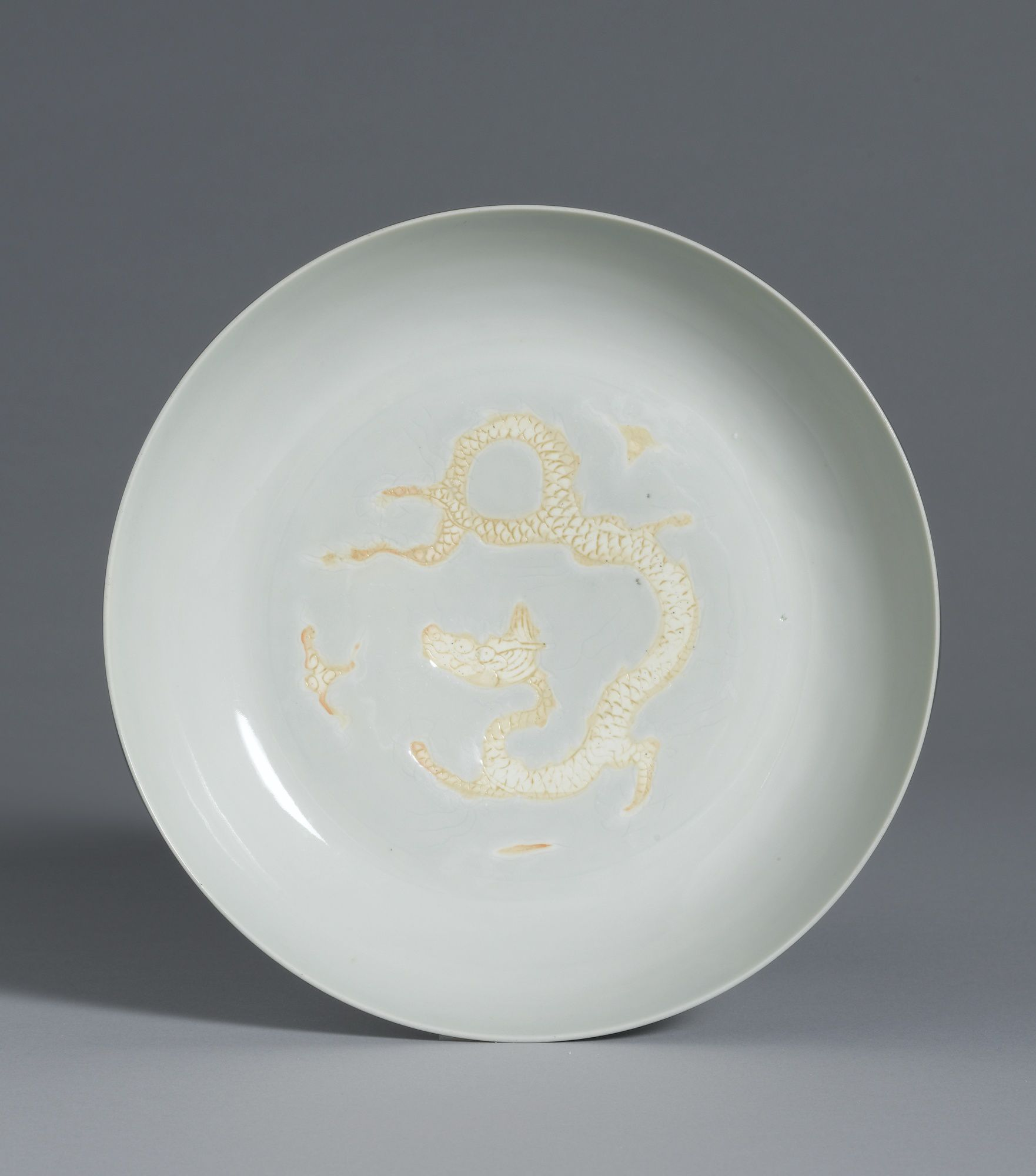 A fine and rare biscuit-decorated 'Dragon' dish, Mark and period of Hongzhi. Photo: Sotheby's.