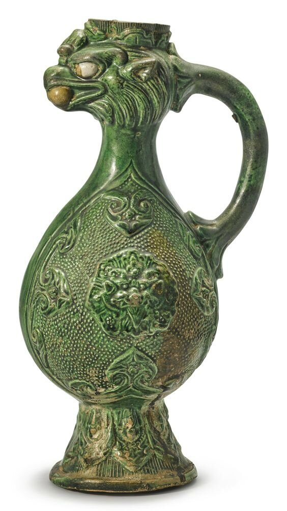 An exceptionally rare green-glazed phoenix-head pottery ewer, Tang dynasty (618-907)