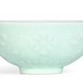 A fine celadon-glazed moulded 'floral' bowl, Mark and period of Yongzheng (1723-1735)
