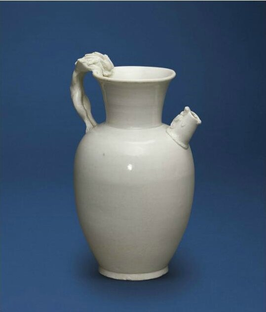 A white-glazed  'Dragon and Lion' ewer, Tang-Five Dynasties (618-960)
