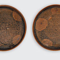 Two small black glazed dishes of Cizhou type with russet splashes and silvery flecks, Jin dynasty (1115-1234)