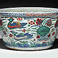 An important and extremely rare wucai 'Ducks and Lotus Pond' fish bowl, Wanli six-character mark in underglaze blue in a line within a double-rectangle and of the period (1573-1619)