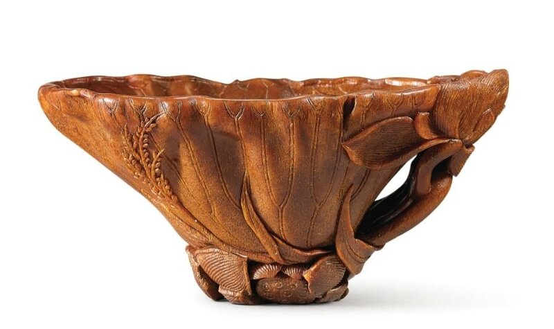 A finely carved rhinoceros horn 'Lotus leaf' libation cup, 17th century