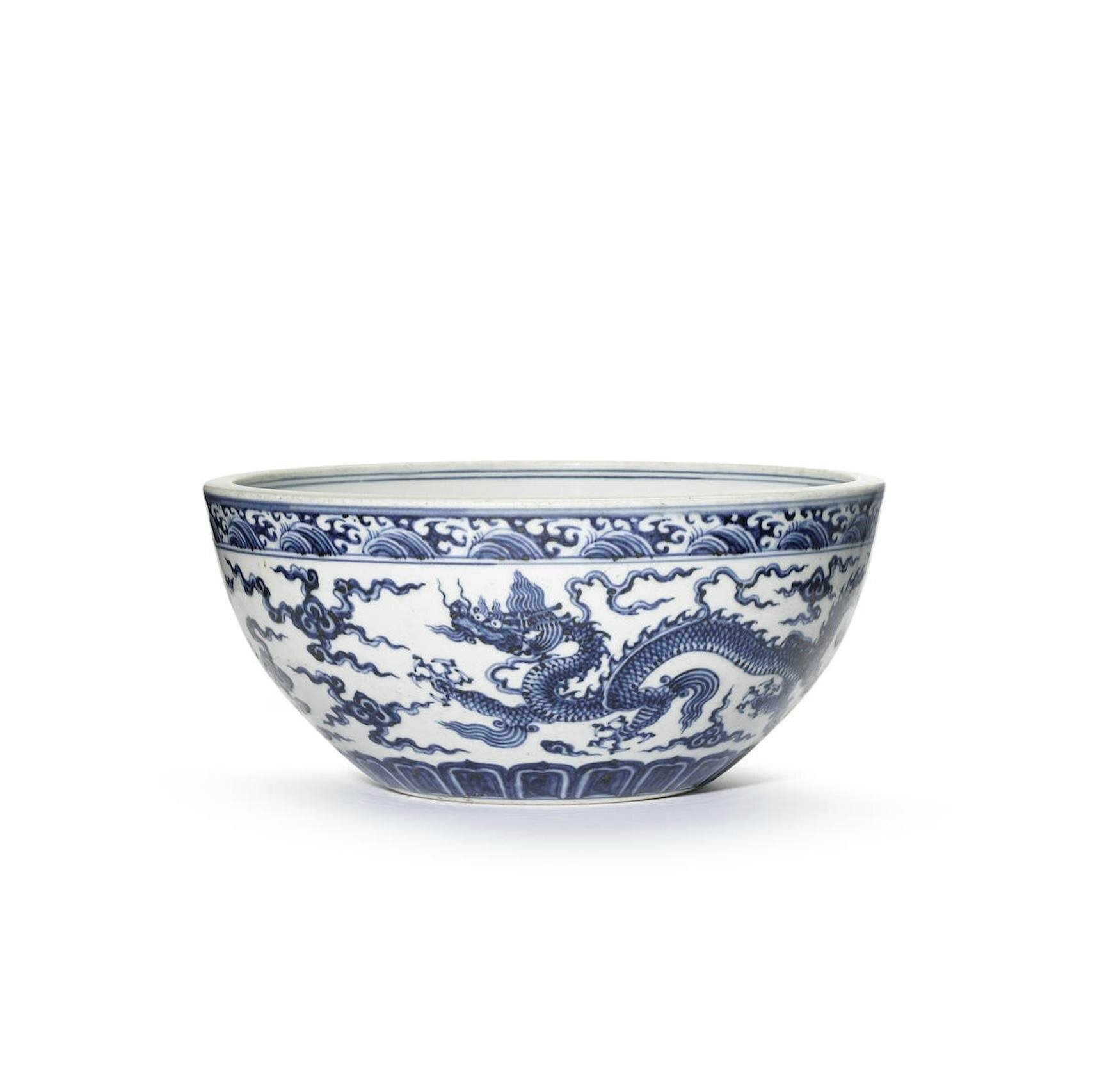 A blue and white 'dragon' dice bowl, Xuande six-character mark and of the period (1426-1435)