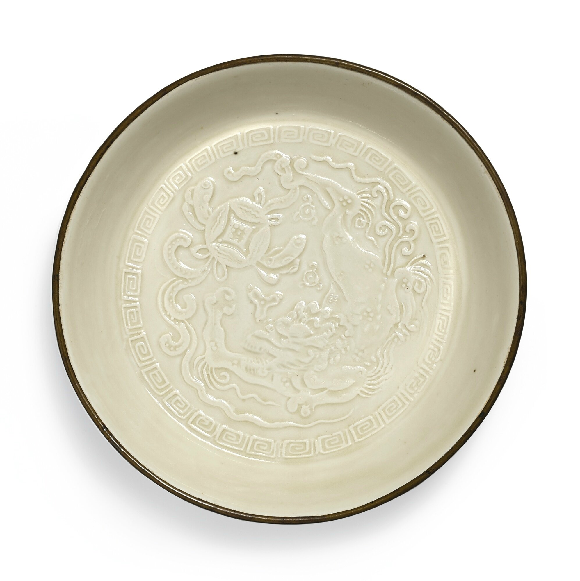 A rare Dingyao moulded 'Buddhist Lion' dish, Jin dynasty (1115-1234)