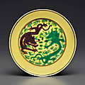 A rare small green and aubergine-decorated yellow-ground 'dragon' dish, kangxi six-character mark and of the period (1662-1722)
