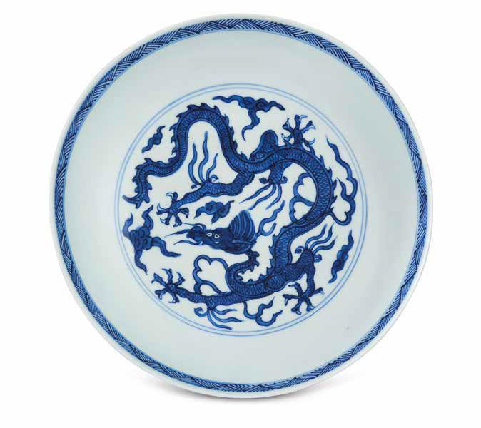 An Incised Blue And White 'Dragon' dish, Wanli Six-Character Mark In Underglaze Blue Within A Double Circle And Of The Period (1573-1619)