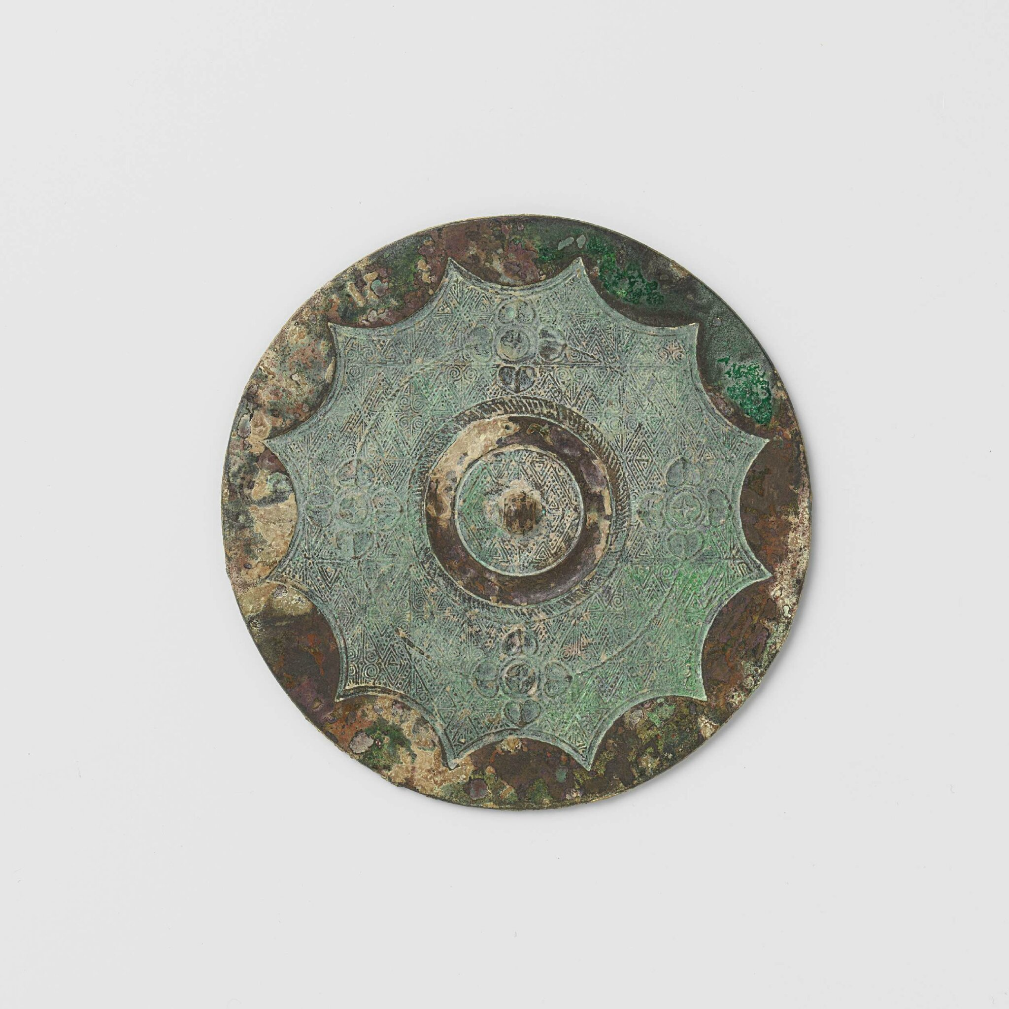 Bronze mirror with scalloped edge and rosettes, Warring States Period, 500-200 BCE