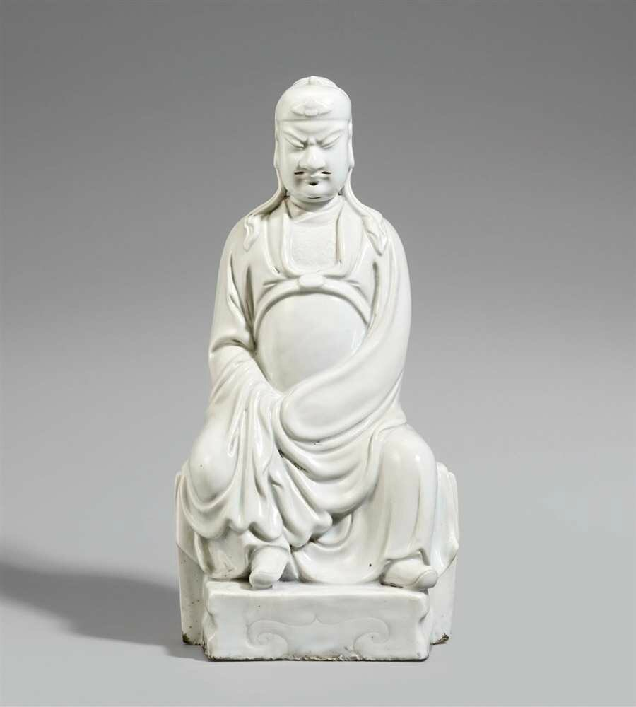 A blanc de Chine figure of a seated Guandi