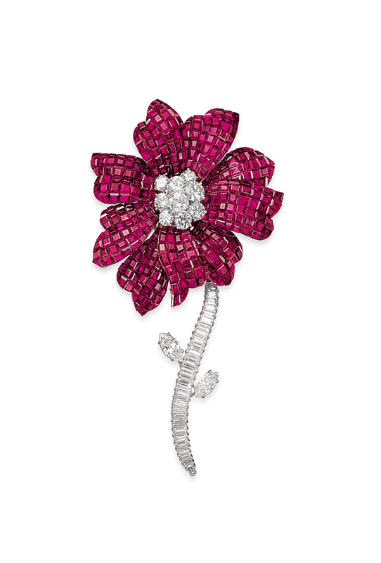 2013_GNV_01400_0228_000(a_mystery-set_ruby_and_diamond_magnolia_brooch_by_van_cleef_arpels)