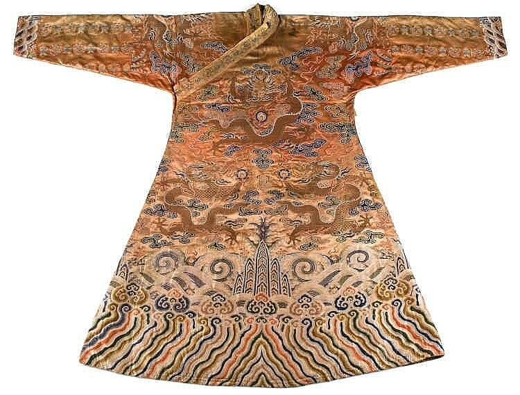 A coral ground silk Tibetan chuba, tailored from 18th century Chinese kesi1