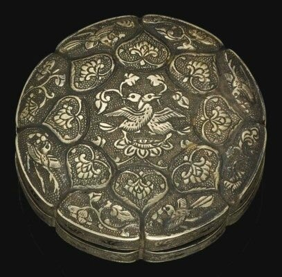 A very rare small parcel-gilt silver lobed circular box and cover, Tang dynasty (618-907)