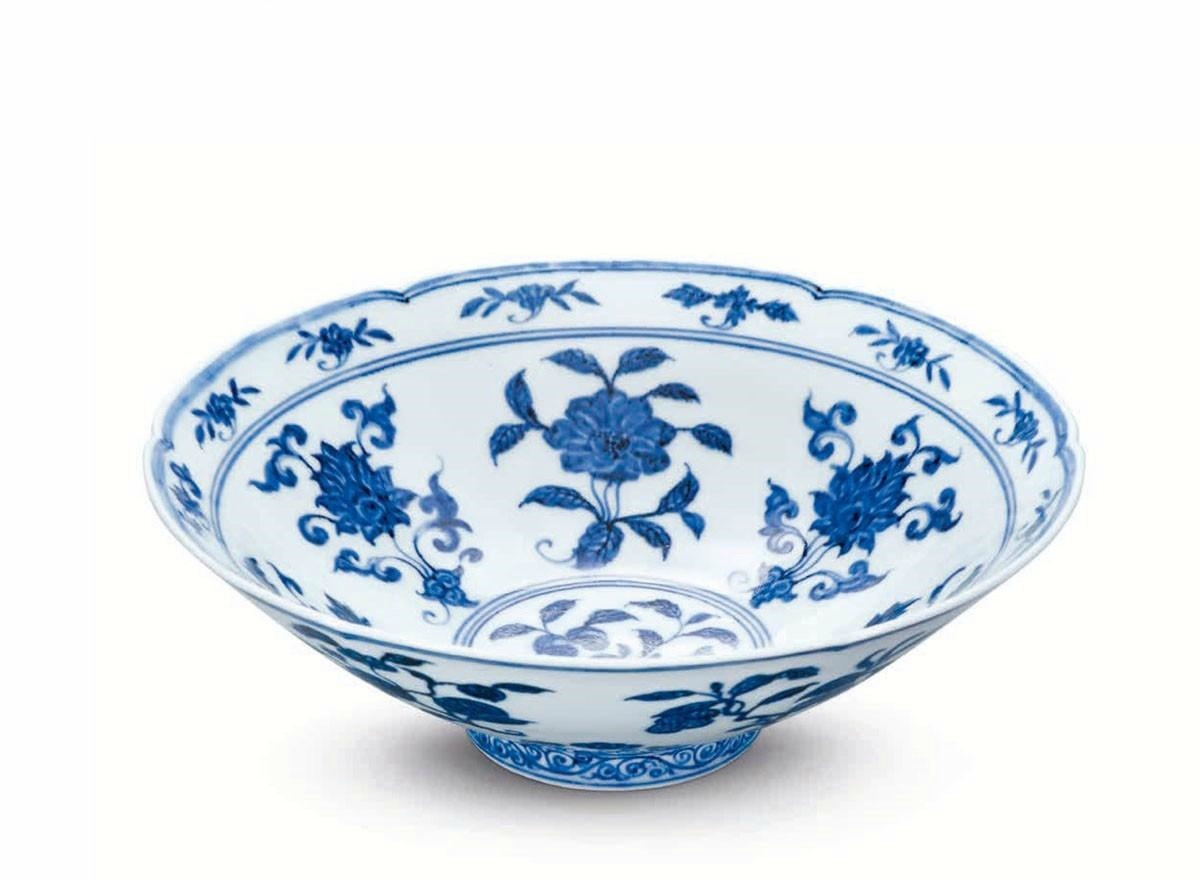 A rare blue and white 'fruit and flower' hexafoil bowl, Xuande six-character mark in underglaze within a double circle and of the period