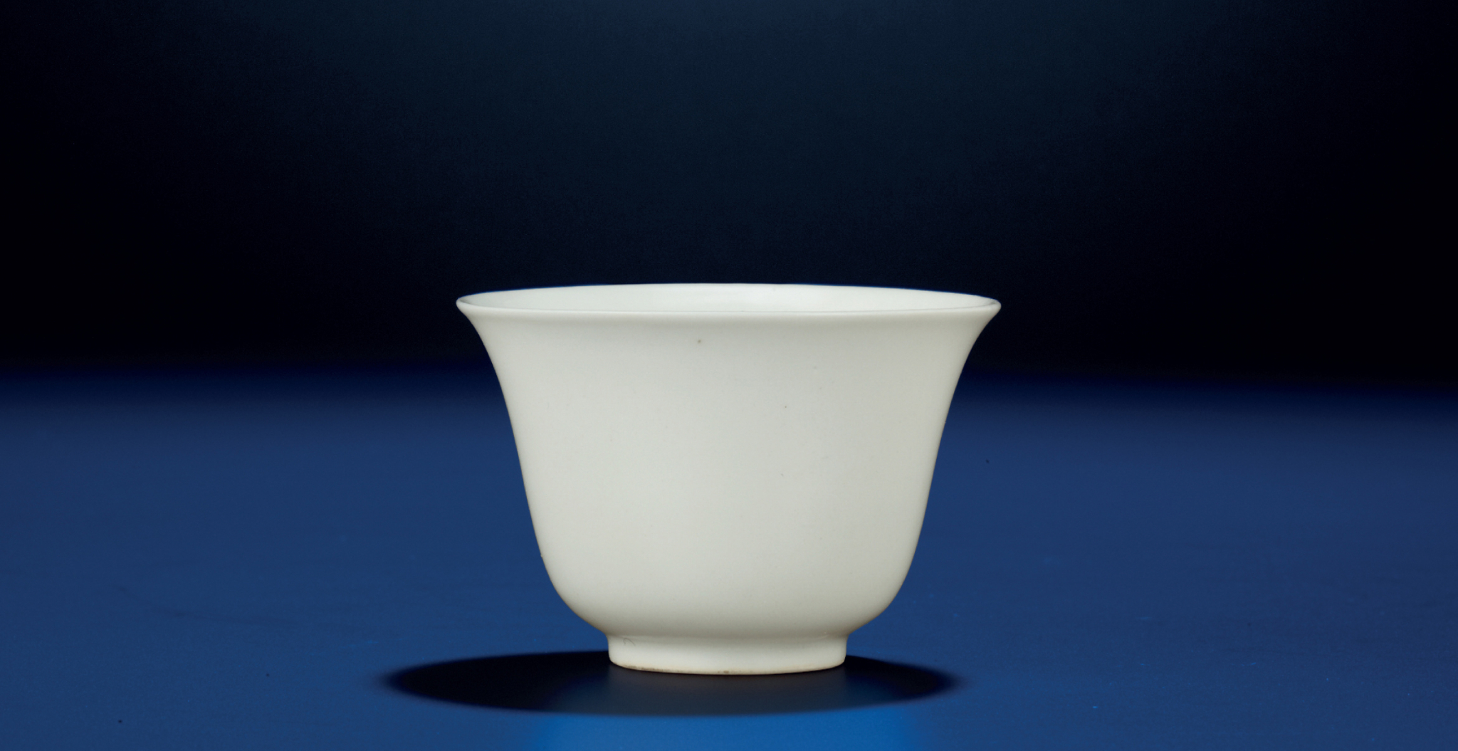 A fine and very rare early Ming white-glazed wine cup, Xuande six-character mark and of the period (1426-1435)