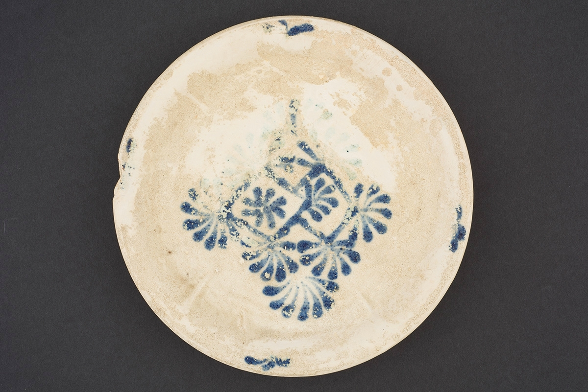 Blue and white dish with floral lozenge decoration, China, Henan Province, Gongxian kilns, Tang dynasty, ca