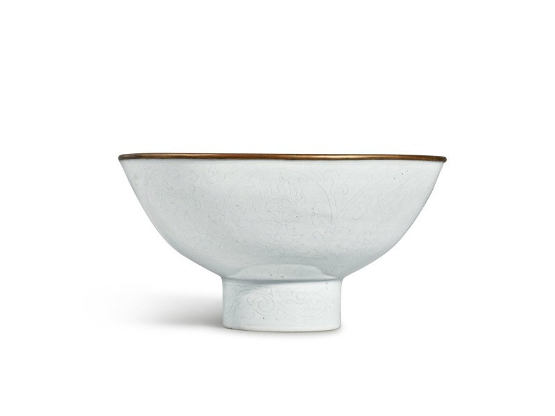 An exceptionally rare white-glazed 'Eight Buddhist Emblems' stem bowl, Mark and period of Xuande (1425-1435)
