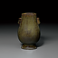 A rare miniature tea-dust-glazed hu-form vase, Qianlong four-character inscribed seal mark and of the period (1736-1795)