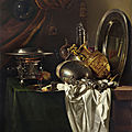 Willem kalf, a chafing dish, two pilgrims' canteens, a silver-gilt ewer, a plate and other tableware on a partially draped table