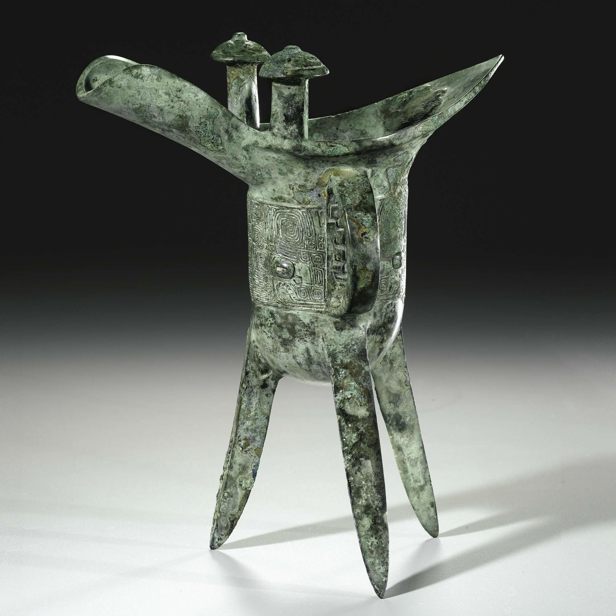 An archaic bronze ritual wine vessel, jue, Shang dynasty (c